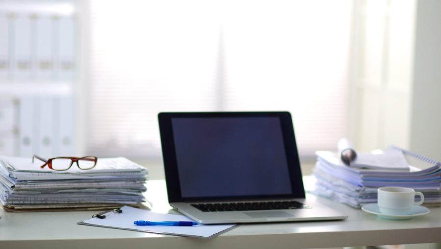 Desk_paperwork_stackofpaper