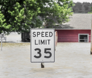 Flood-house-speed-limit-sign