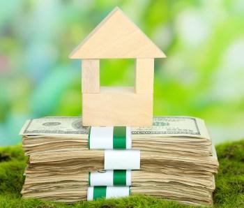 Wooden-block-house-on-money