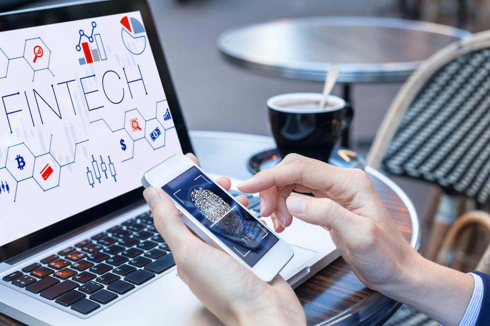 Businesswoman scanning fingerprint on smartphone, data security, fintech screen concept
