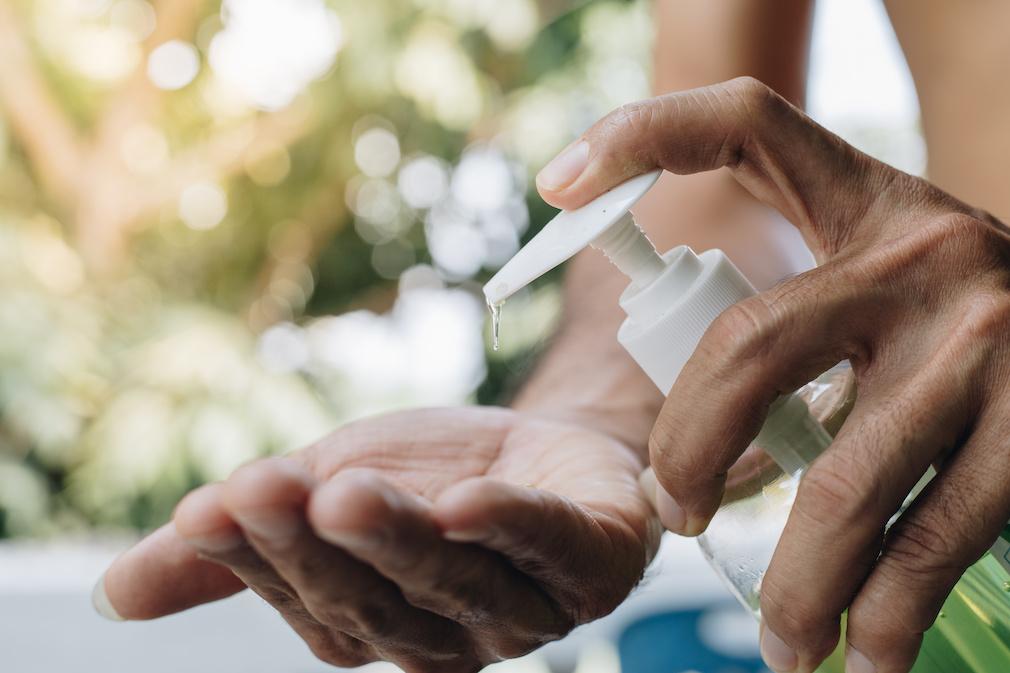 Close Up man using a hand sanitizer