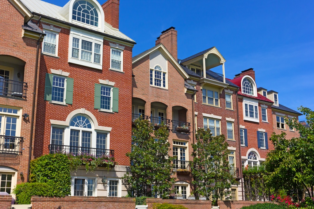 Modern houses facing Old Town Alexandria waterfront in Virginia, USA. Highly sought after residential development in Alexandria neighborhood.