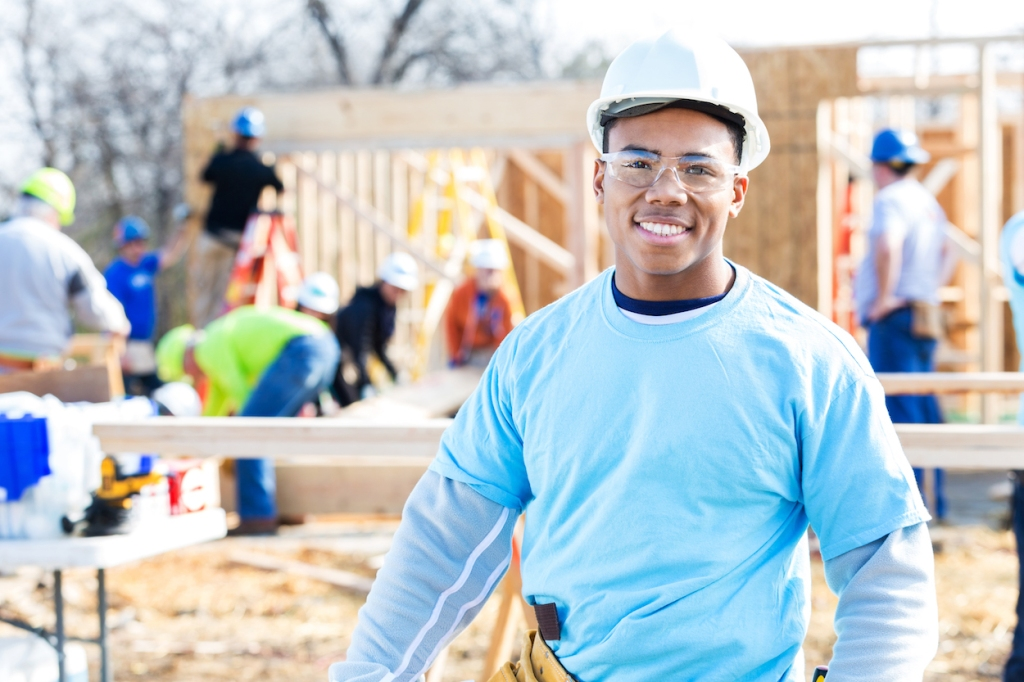 Confident volunteer construction foreman at work site