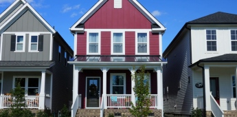 Two story, red, row house in a suburban neighborhood in North Carolina