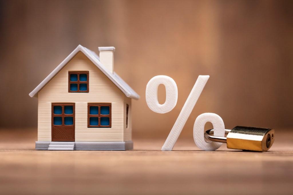 House Model Near Percentage Sign With Keypad Lock