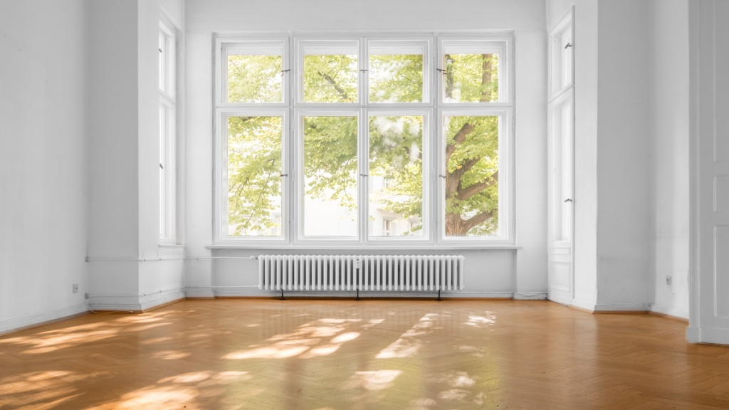 empty room in old apartment building with  parquet floor and big wooden windows