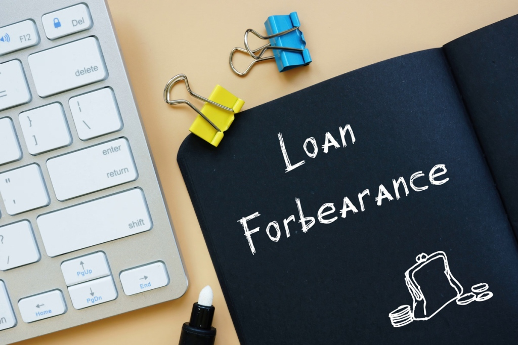 Business concept meaning Loan In Forbearance with sign on the page.