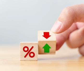 Interest rate financial and mortgage rates concept. Hand flip wood cube change arrow down to up