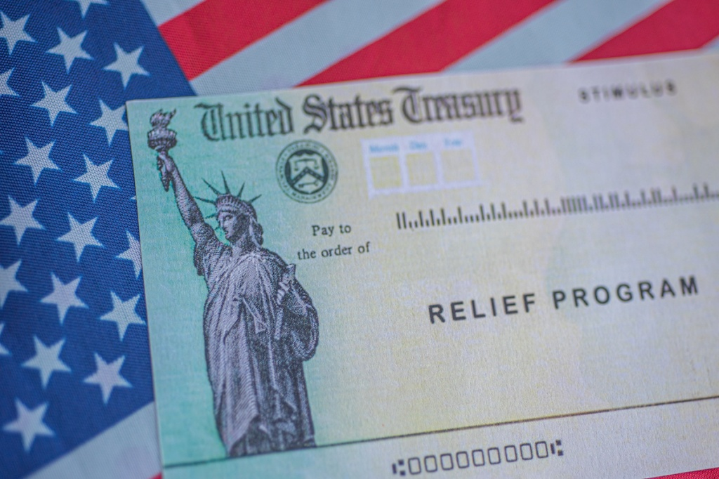 Washington, DC, USA - March, 16, 2020: Stimulus check relief program concept.