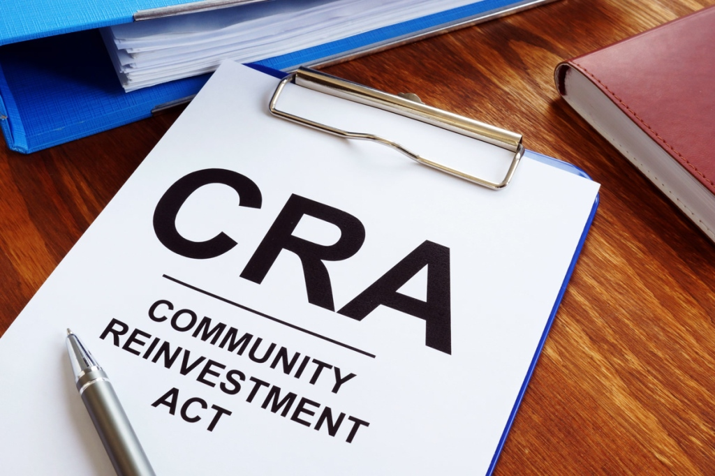 Community Reinvestment Act CRA in the blue clipboard.