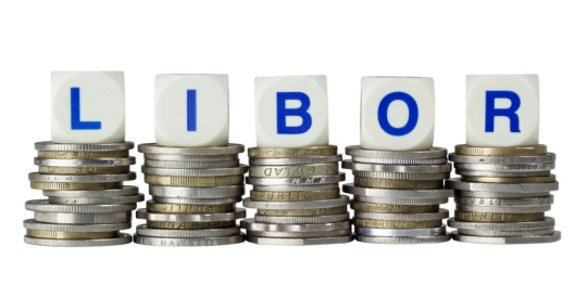 Stacks of coins with the letters LIBOR isolated on white
