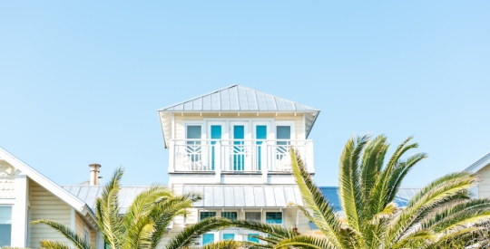 Wooden house tower new urbanism modern architecture by beach ocean, nobody in Florida view during sunny day