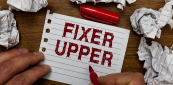 Writing note showing Fixer Upper. Business photo showcasing house in need of repairs used chiefly connection with purchase Man holding marker notebook page crumpled paper several tries mistakes.