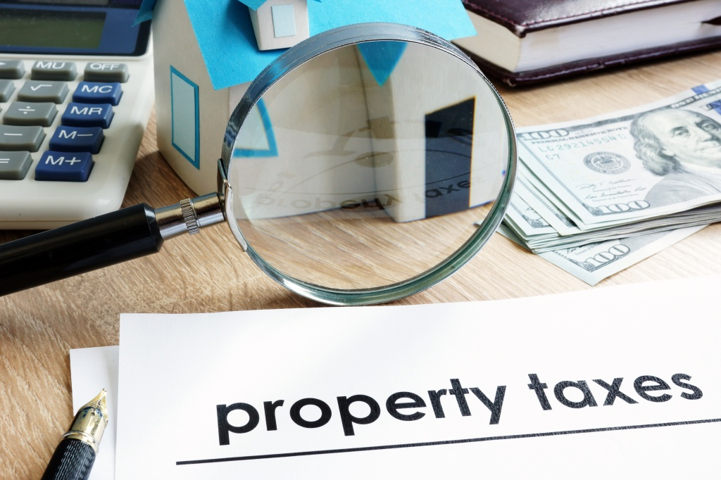 Document with title Property tax on a desk.