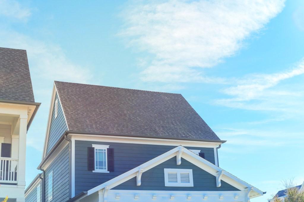 Blue wood siding on cottage style house near Dallas, Texas cloud
